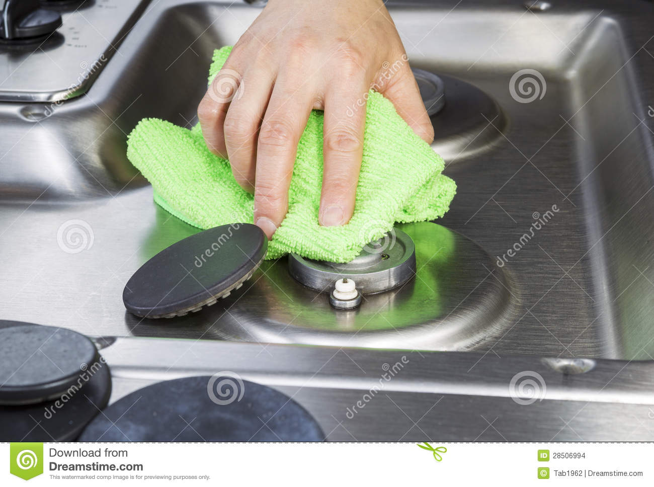 Cleaning stove top with microfiber cloth stock images How to clean top of oven
