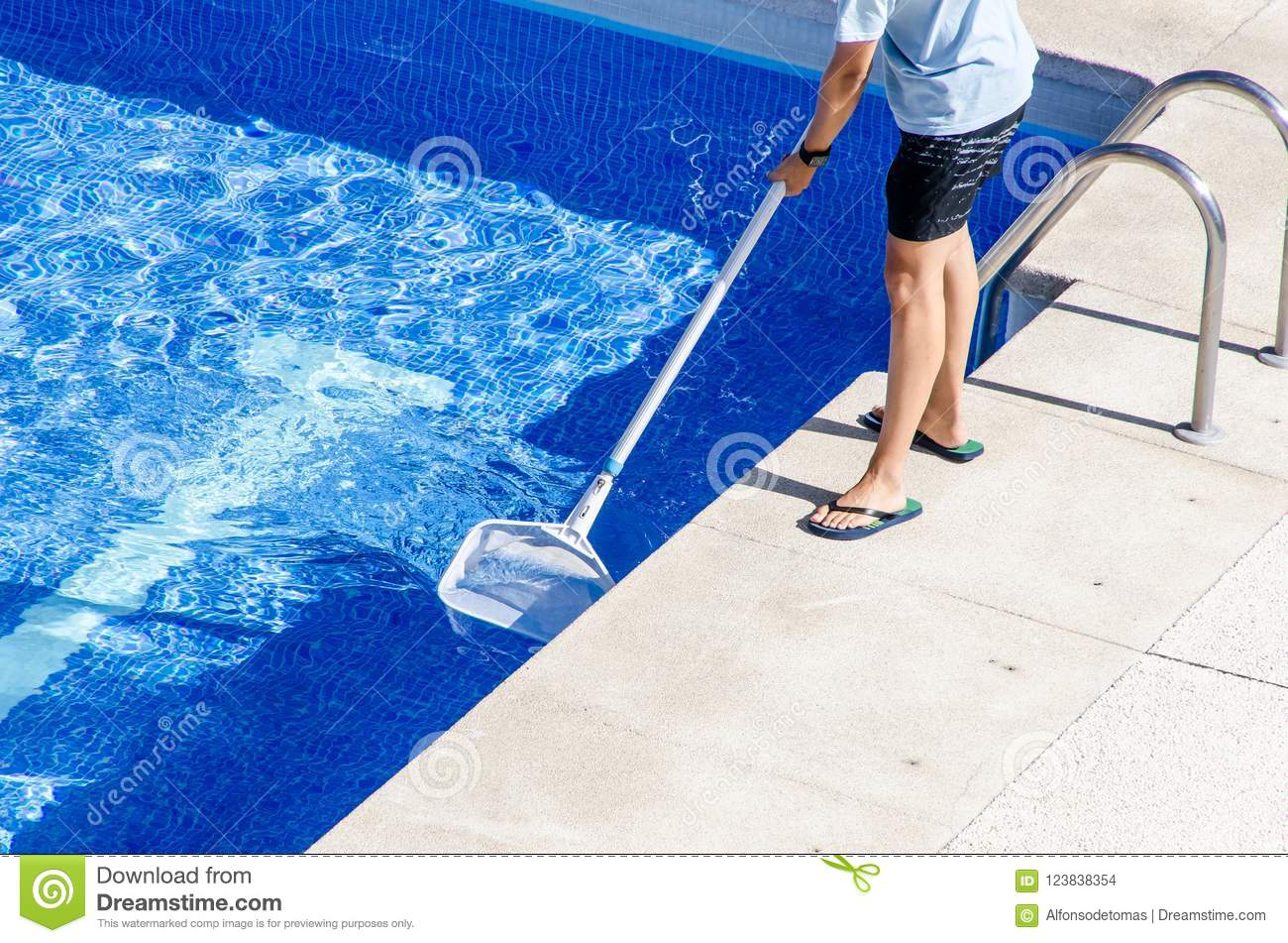 Cleaning The Swimming Pool With A Net Stock Photo - Image of ...