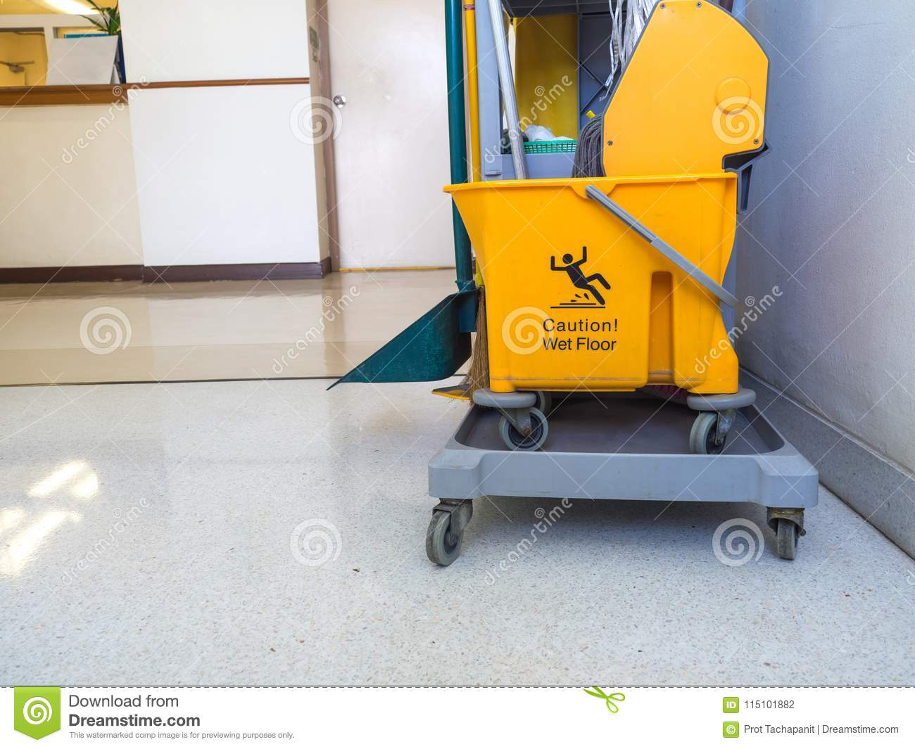 Cleaning tools cart wait for maid or cleaner in the hospital. The warning signs cleaning in process the floor in building. Bucket