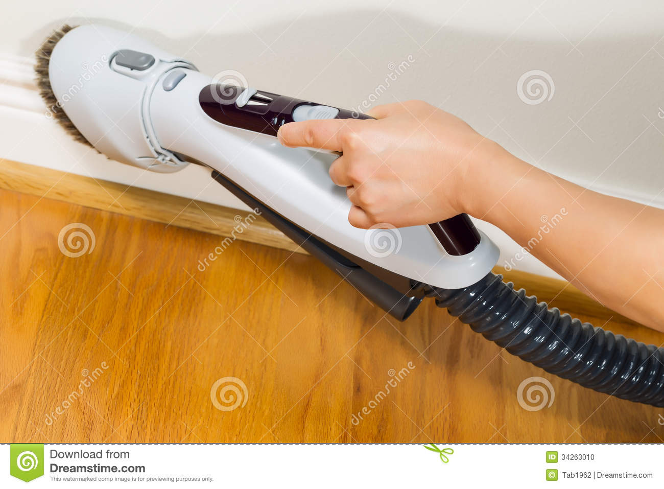 Cleaning Trim Next To Wooden Floors Stock Photo - Cleaning Trim Next To Wooden Floors Stock Photo - Image: 34263010