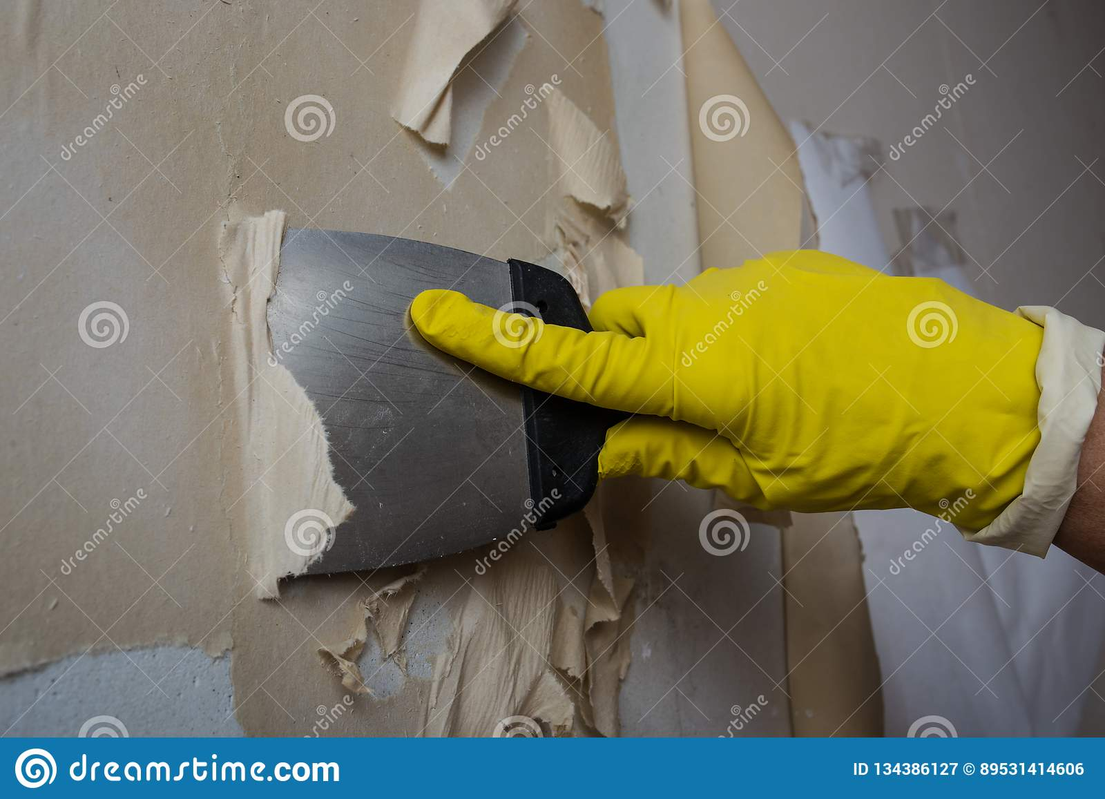 Cleaning The Wall From Old Wallpaper Stock Image Image Of