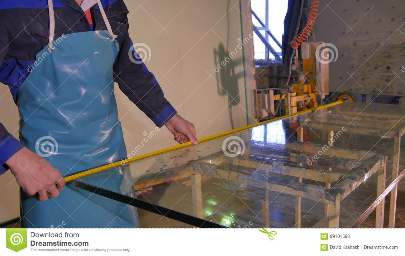 Worker Clean And Dry The Glass On Manufacture  Smiling Mid