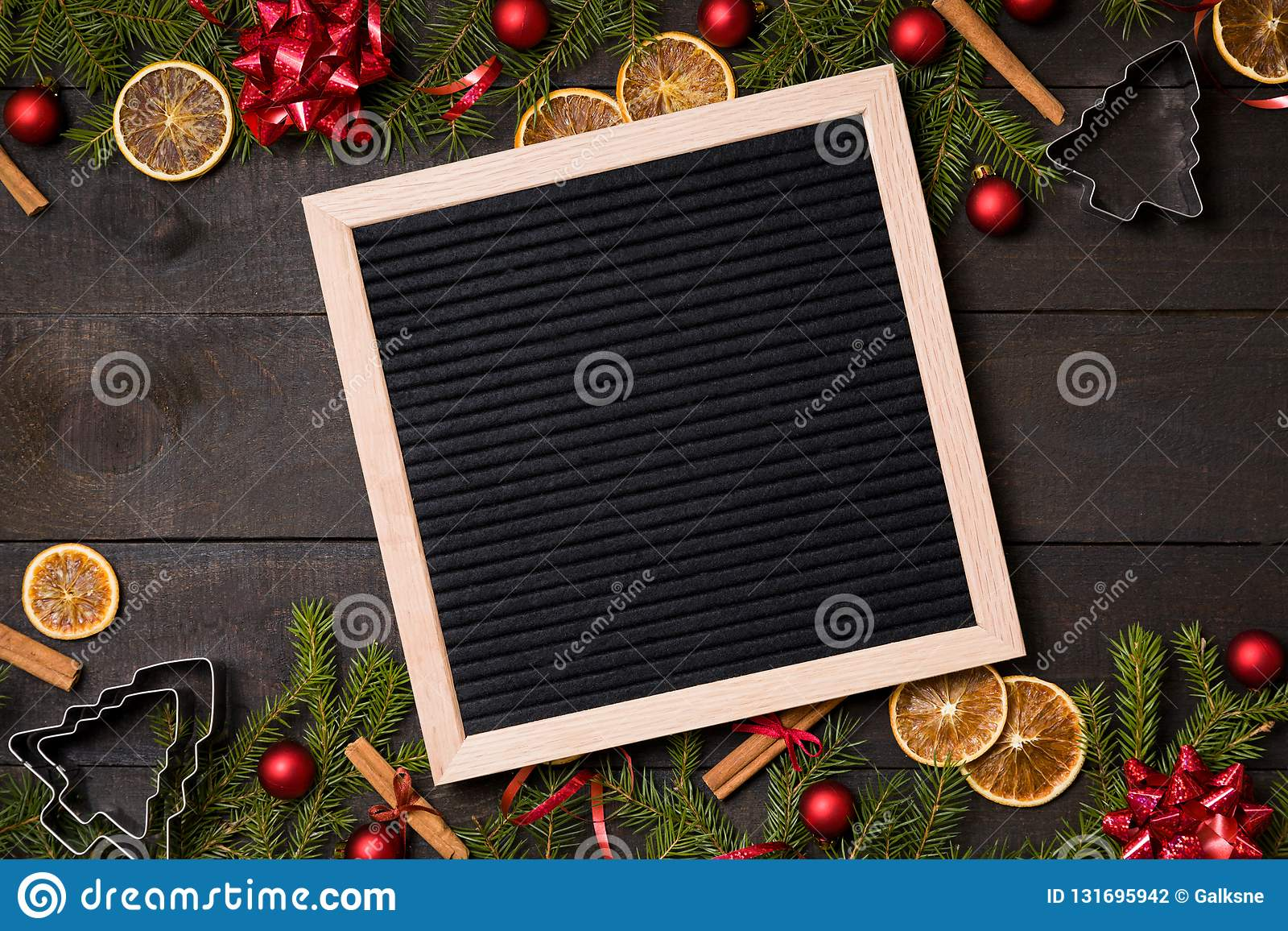 clear black felt letter board flatlay on dark rustic wood table with christmas decoration and fir