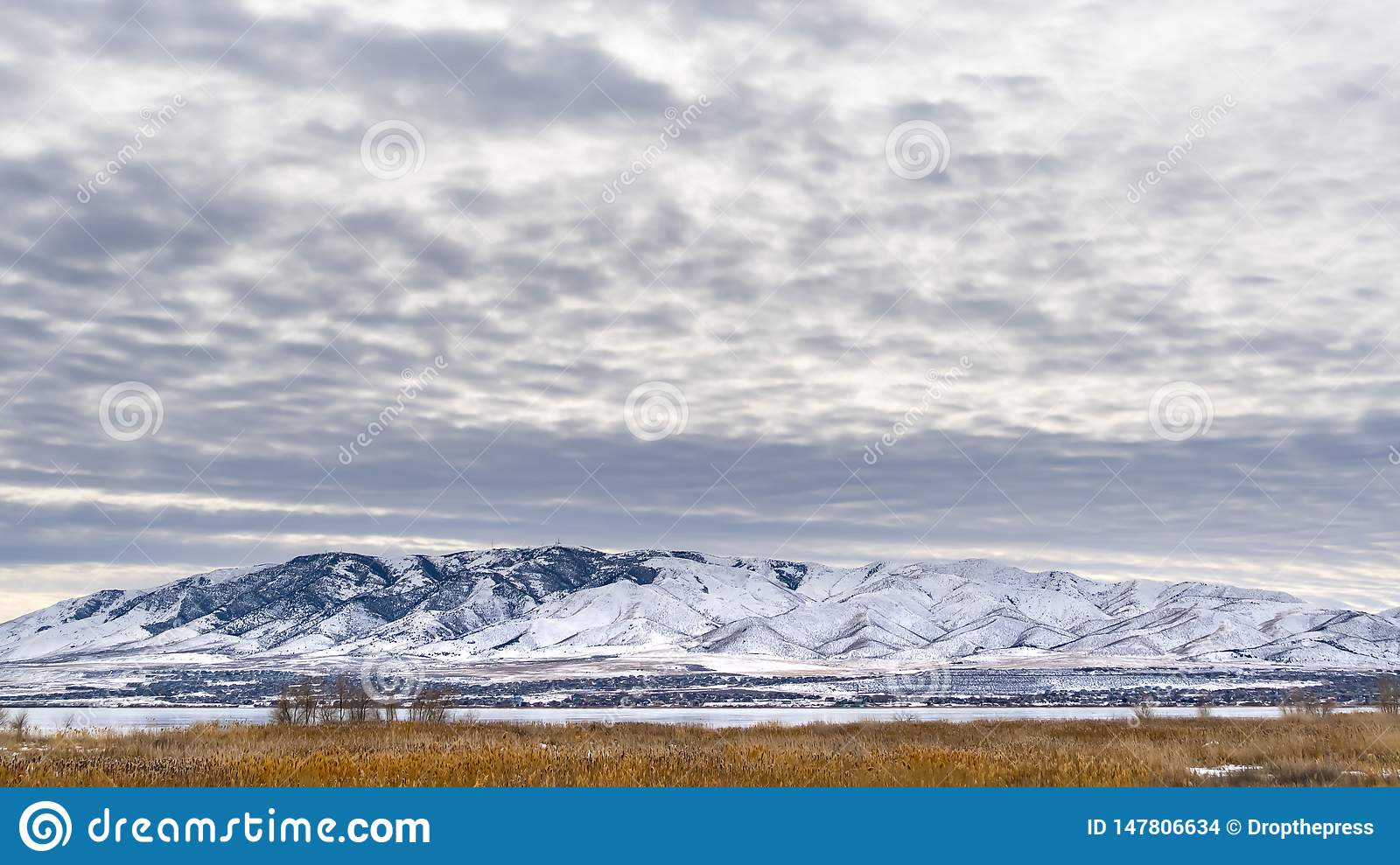 Clear Panorama Dramatic sky filled with cottony clouds over a scenic landscape in winter