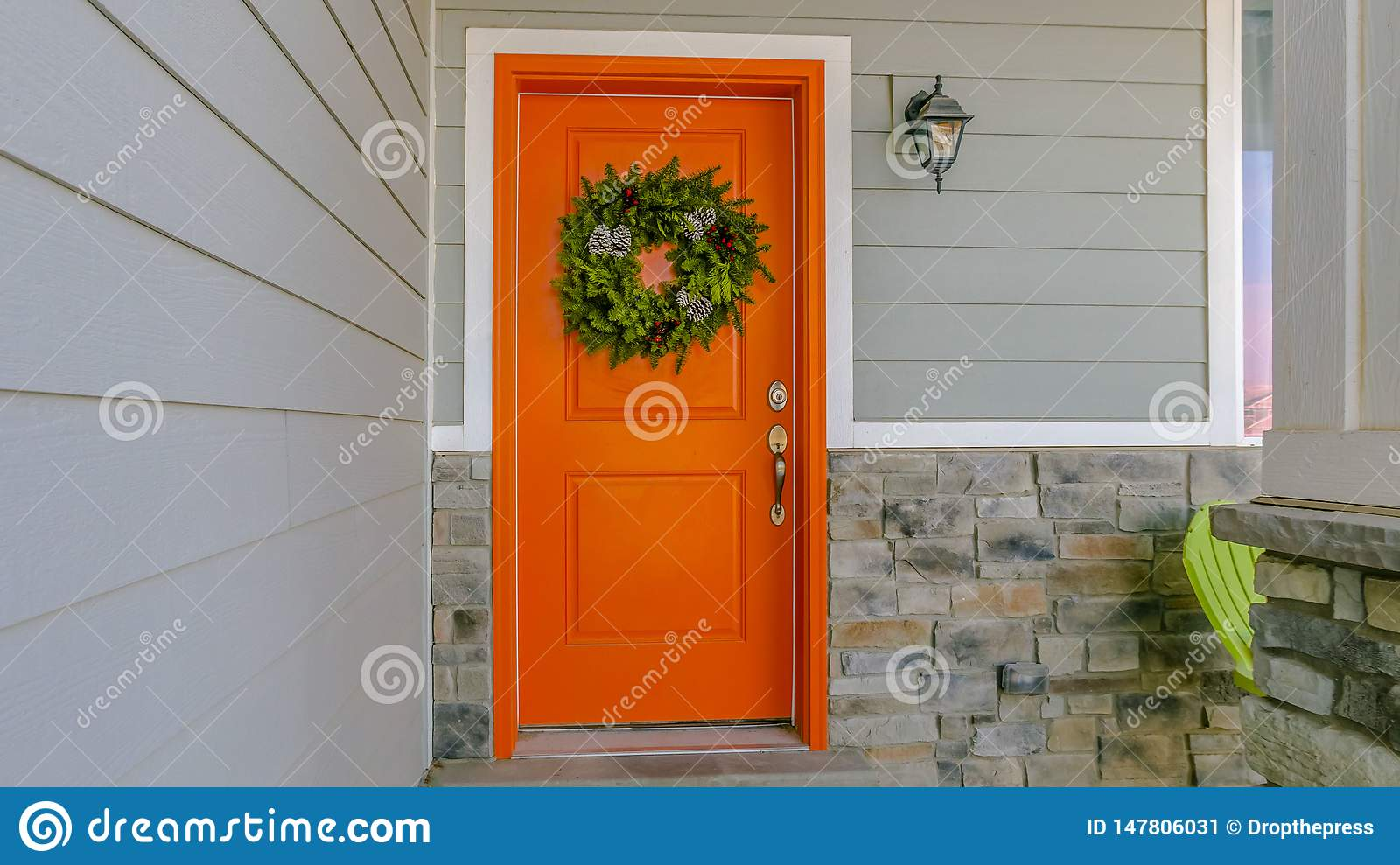 Clear Panorama Home with a welcoming wreath hanging on the orange front door