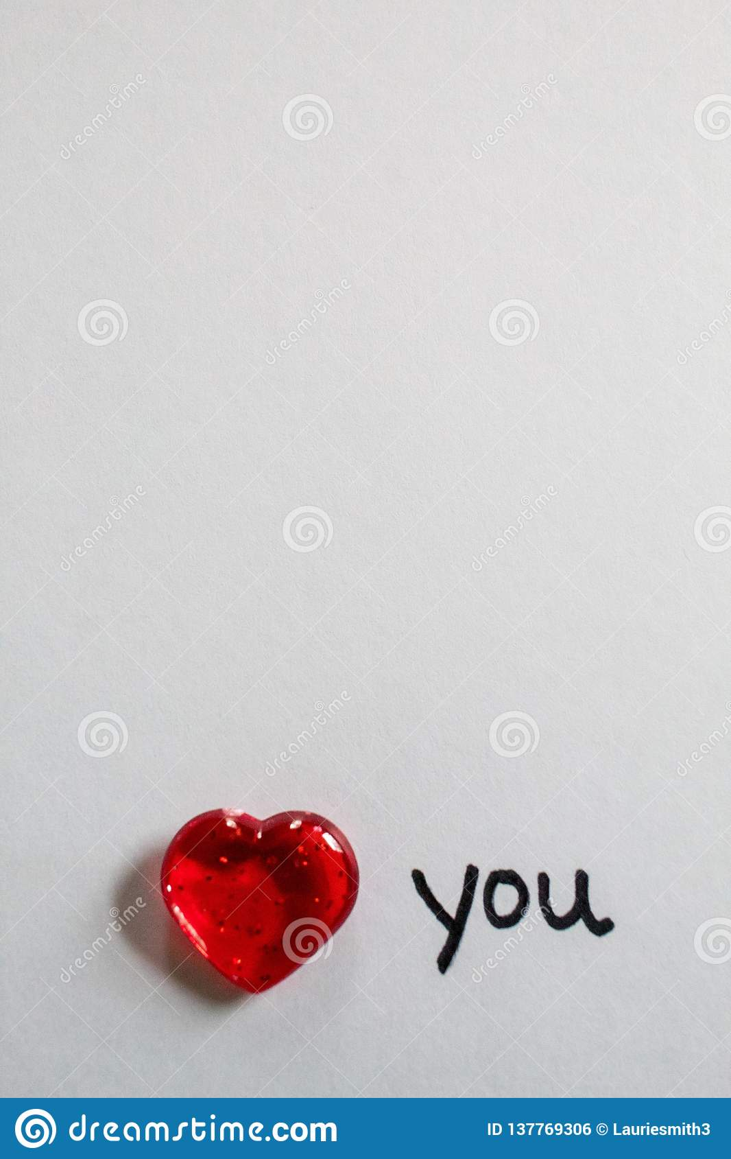 Clear red hearts with love note for Valentine`s Day