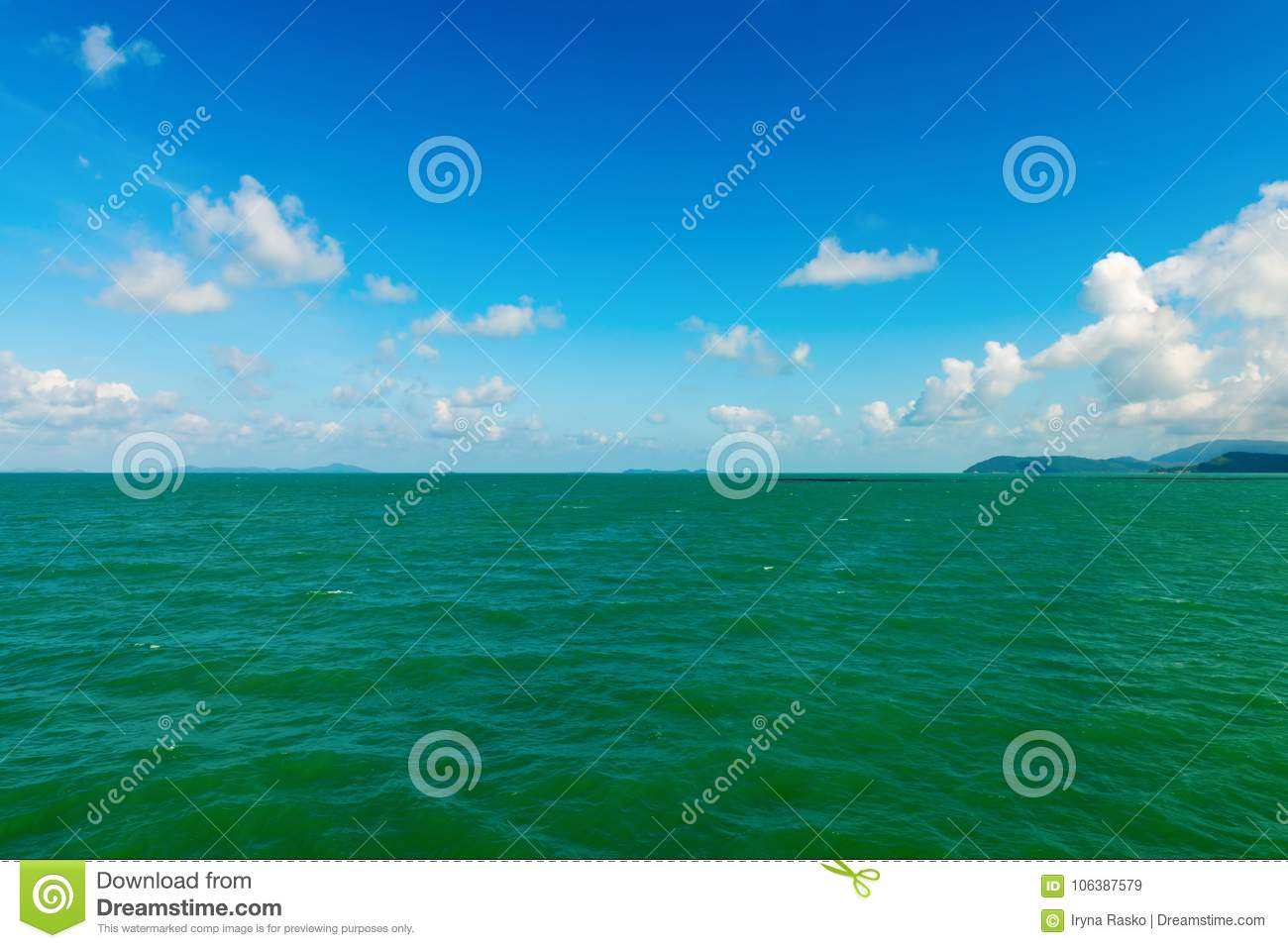 Seascape with green islands on horizon