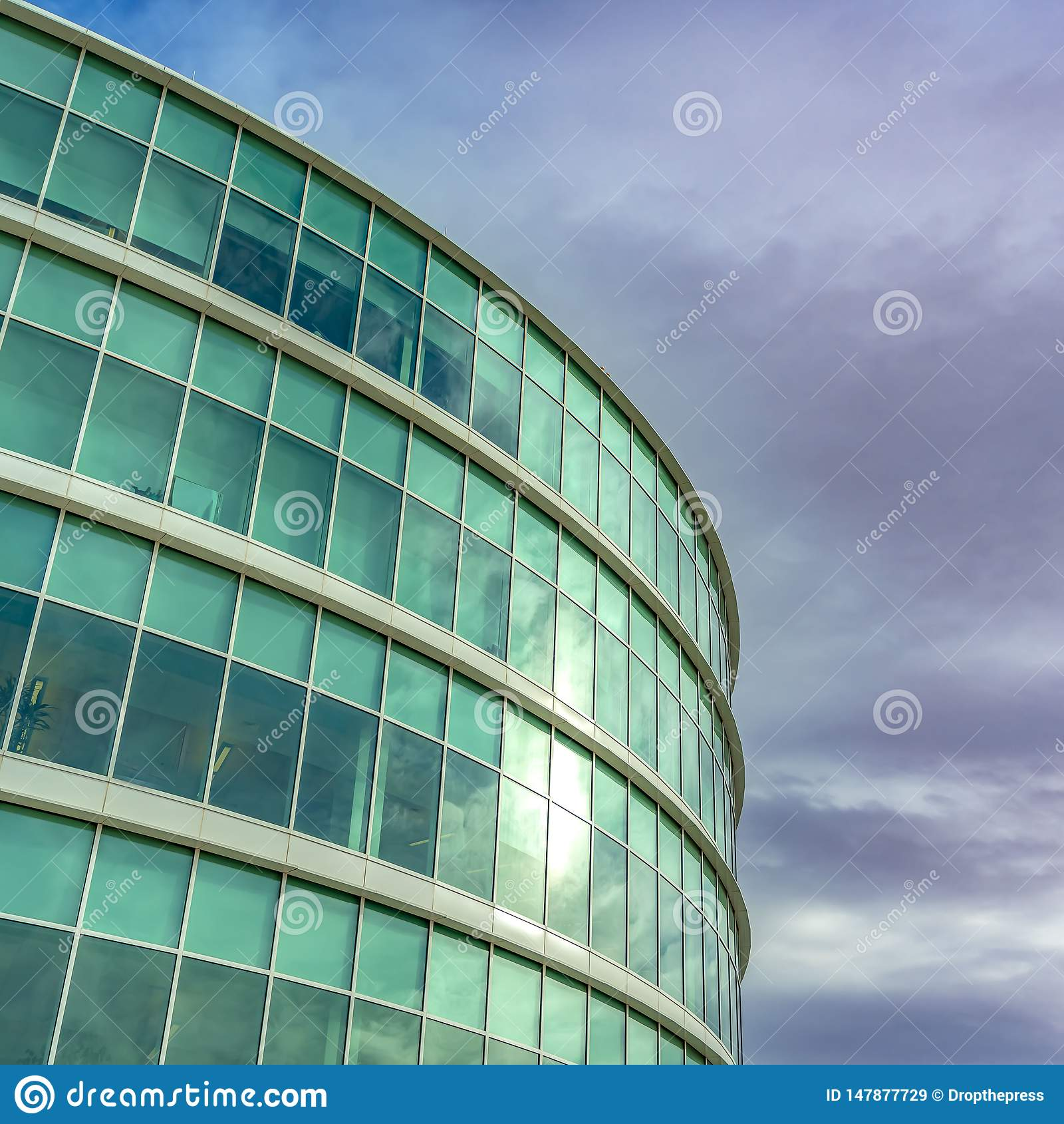 Clear Square Exterior view of a modern office building with reflective glass wall