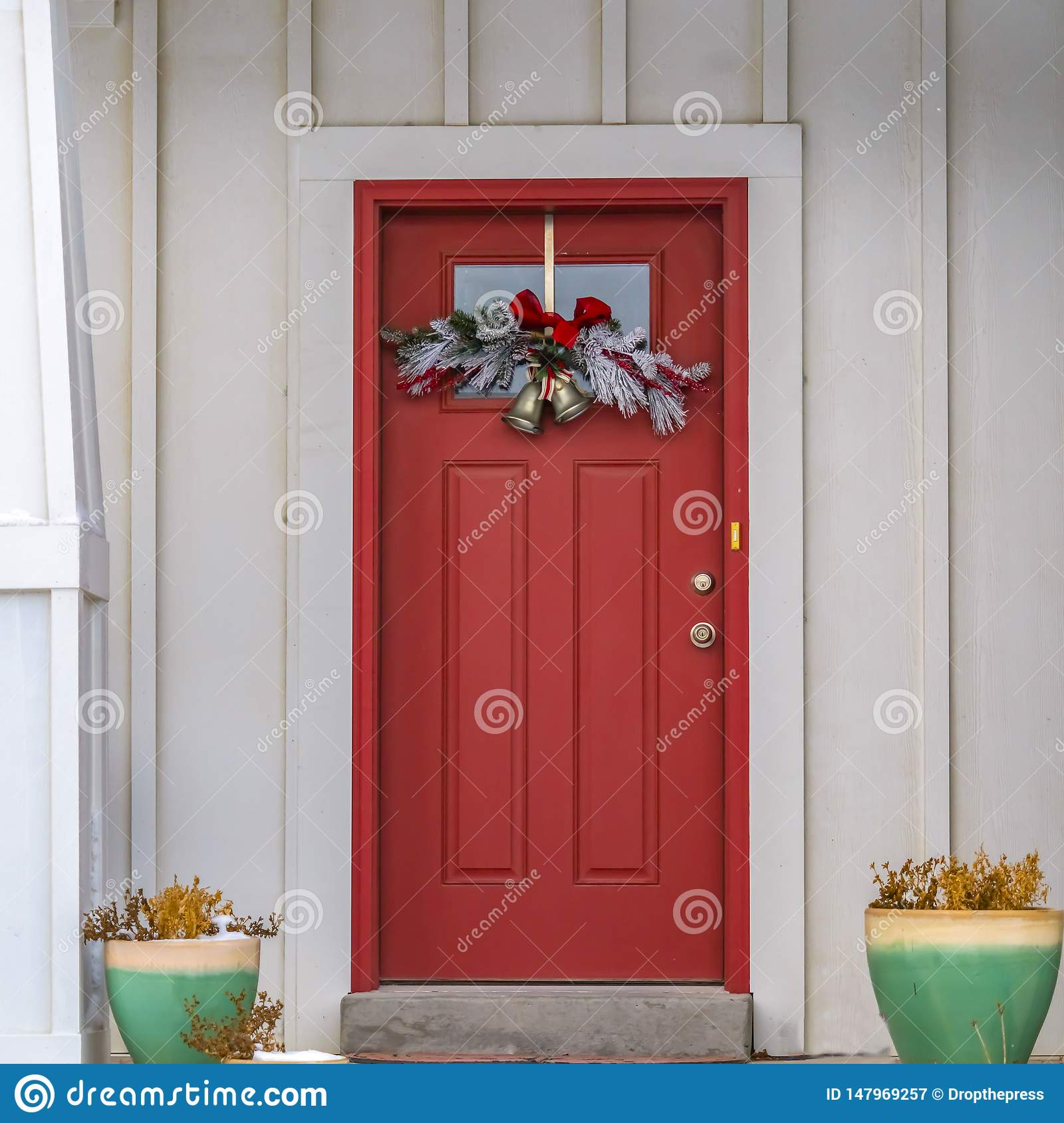 Clear Square Front Door With Glass Panel And Holiday Decoration Against A Ribbed White Wall Stock Image Image Of Facade Steps 147969257