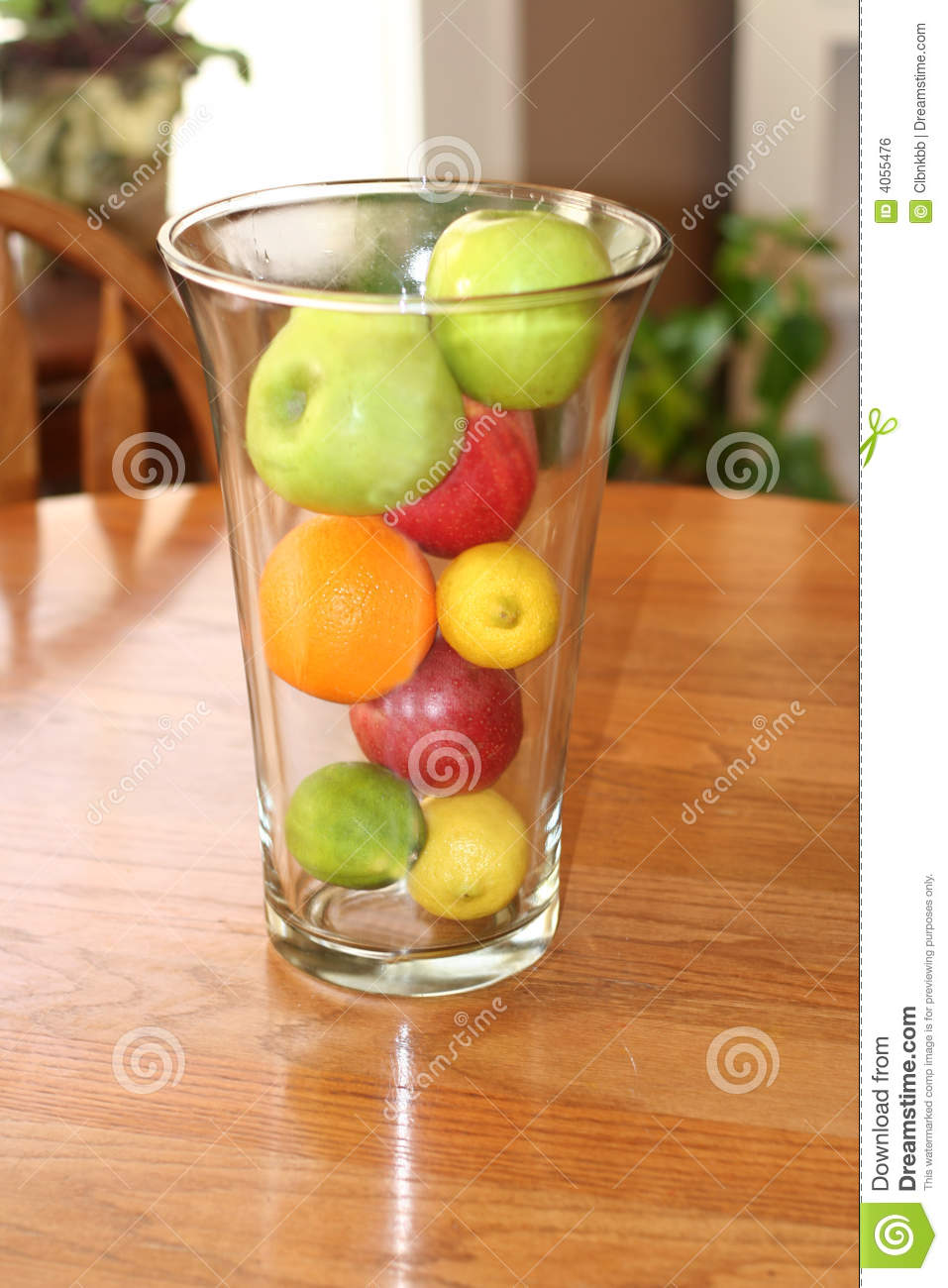 Clear Vase With Fresh Fruit On Wooden Table Stock Photo