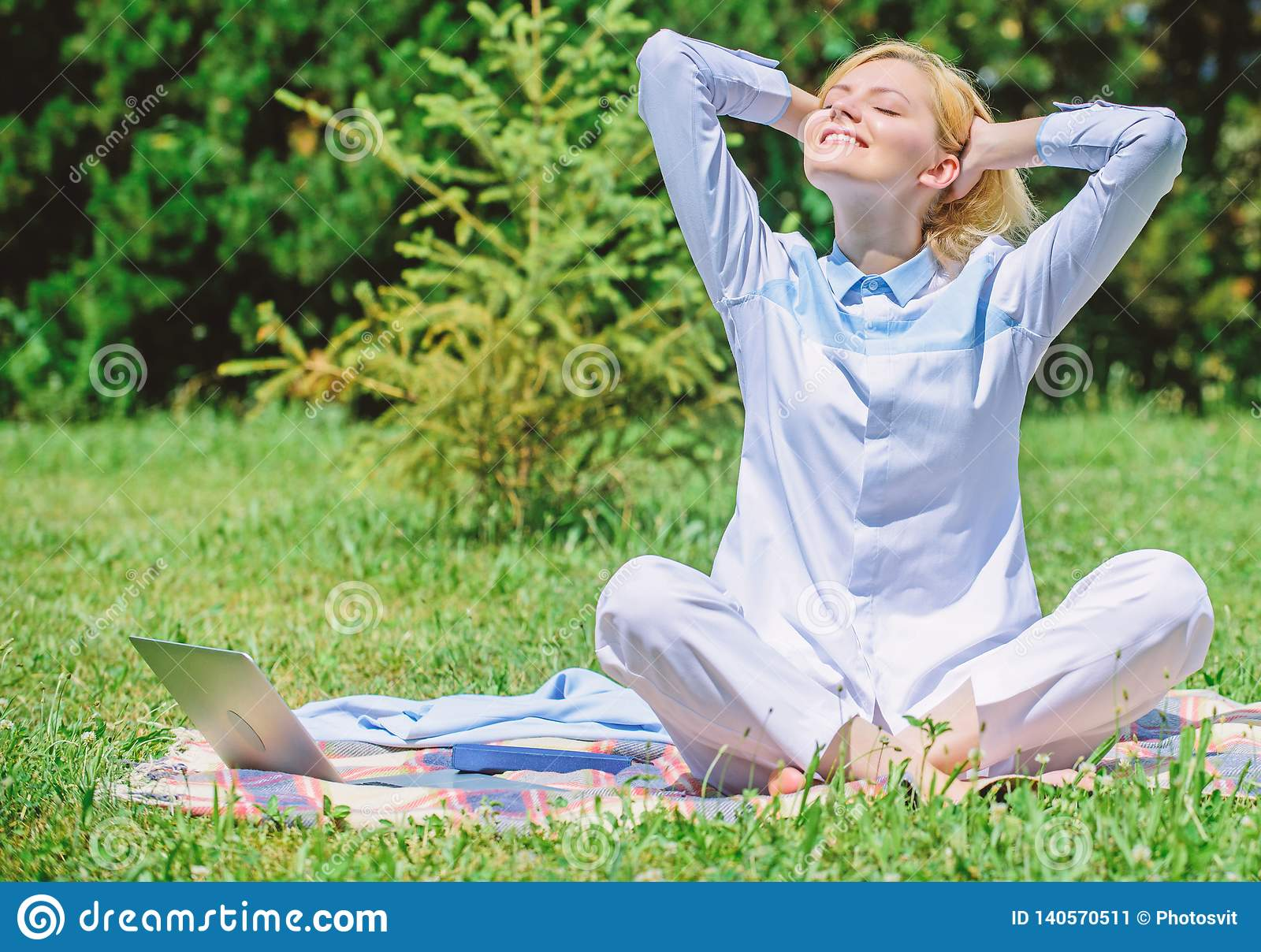 Clear your mind. Girl meditate on rug green grass meadow nature background. Find minute to relax. Woman relaxing