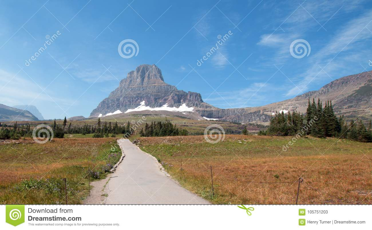 CLEMENTS MOUNTAIN TOWERING ABOVE HIDDEN LAKE HIKING TRAIL ON LOGAN PASS DURING 2017 FALL FIRES IN GLACIER NATIONAL PARK MONTANA US
