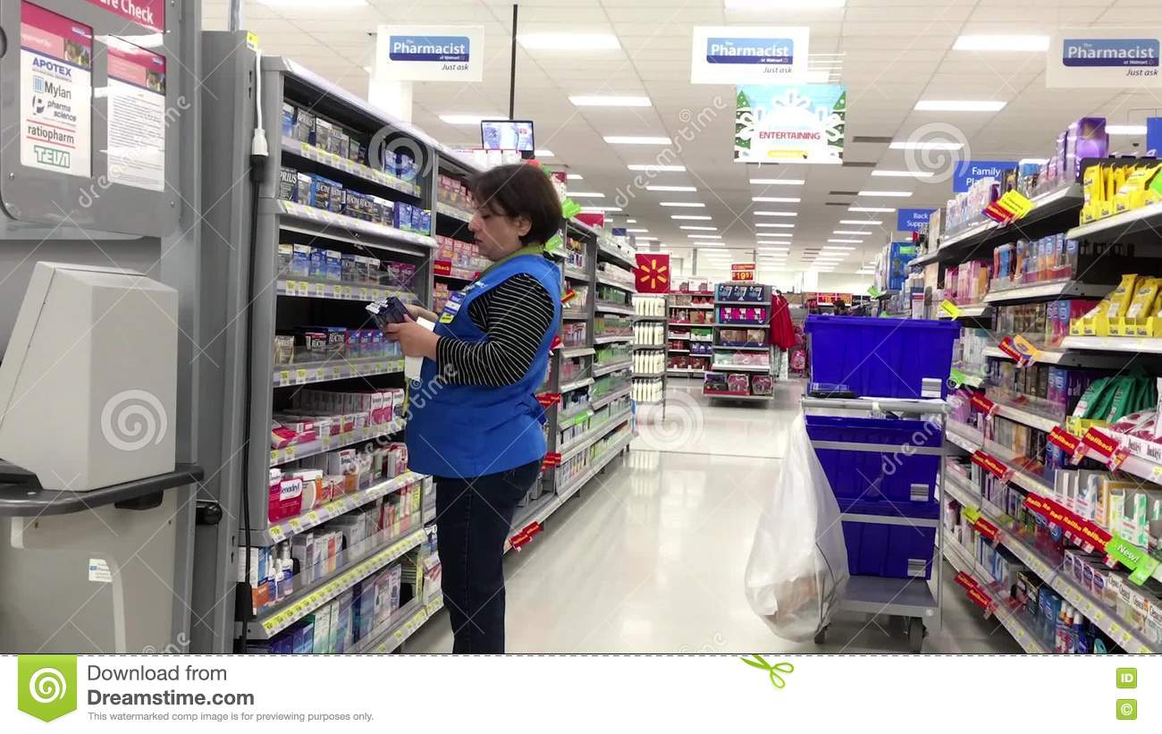 Clerk Stocking Medicine On Shelf At Pharmacy Section Stock Footage ...