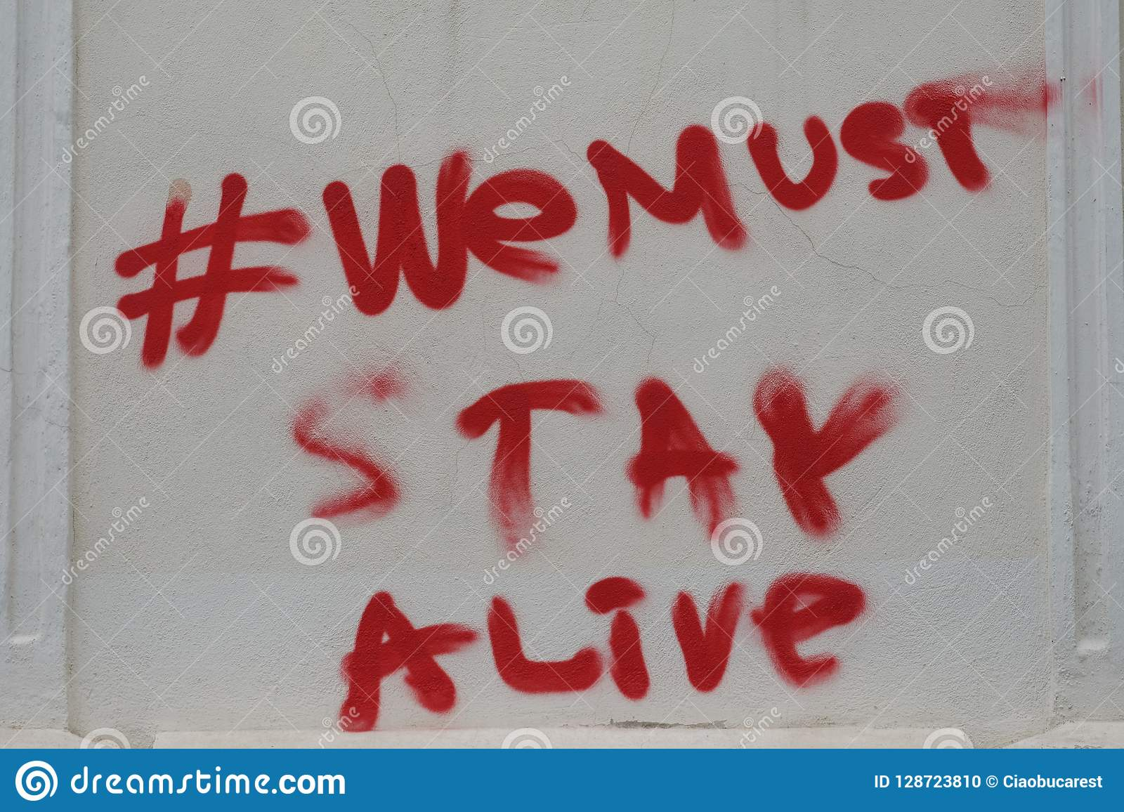We Must Stay Alive Airbrush Quote On A Wall Of Bucharest Stock Photo Image Of Hashtag Stay 128723810