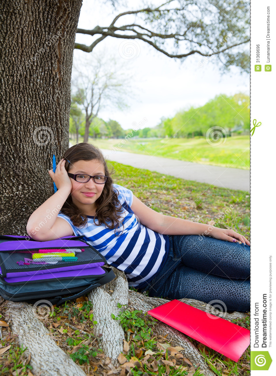 Clever Student Teen Girl With School Bag Under Park Tree