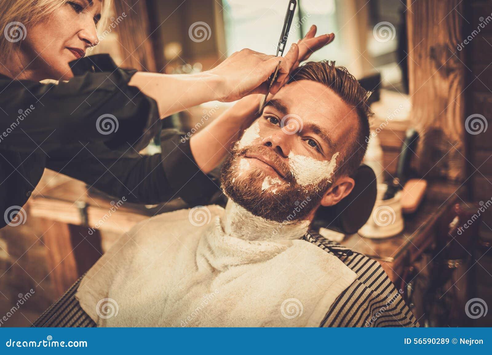 client in barber shop stock photo image 56590289. Black Bedroom Furniture Sets. Home Design Ideas