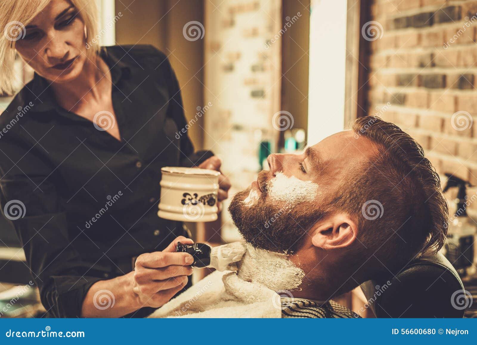 client during beard shaving stock photo image 56600680. Black Bedroom Furniture Sets. Home Design Ideas