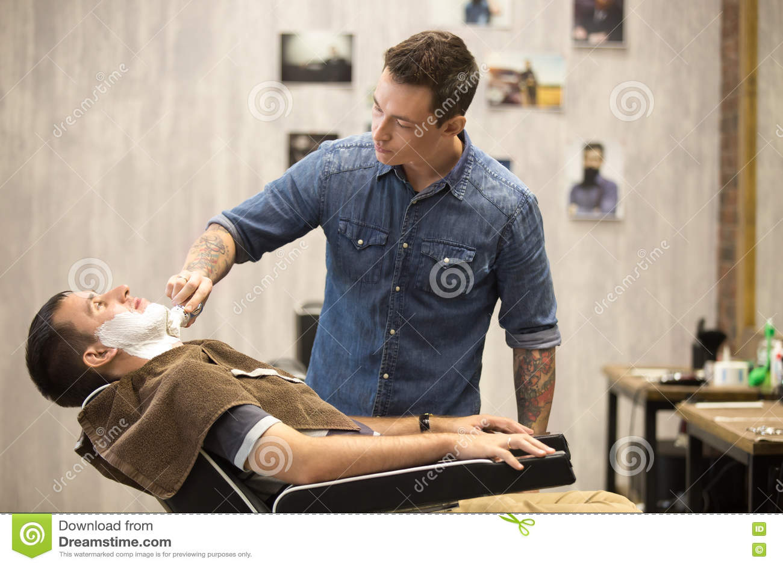 client getting beard shaving in barber shop stock photo. Black Bedroom Furniture Sets. Home Design Ideas