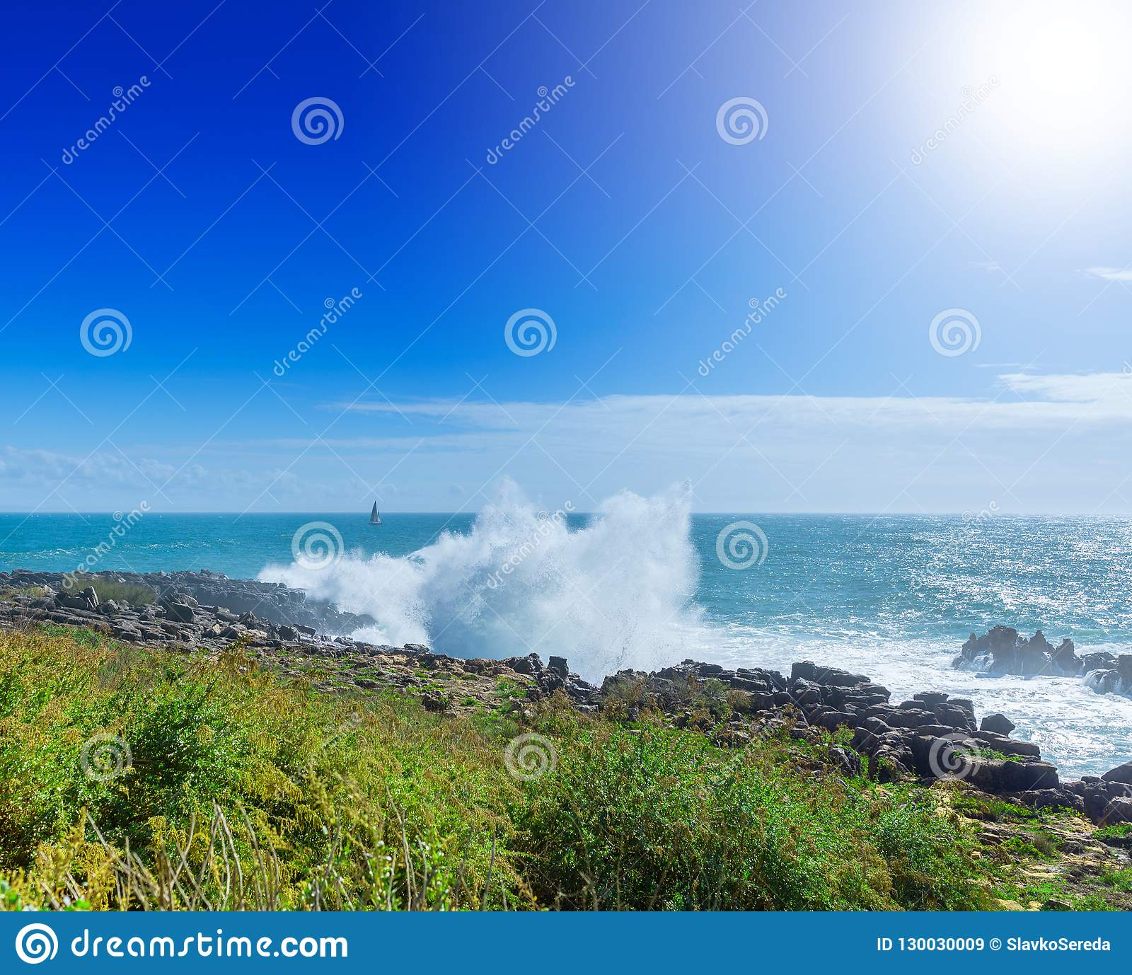The cliffs on the coast of the Atlantic Ocean. Ocean waves, Cascais, Portugal. Beauty in nature. Beautiful marine landscape in ba