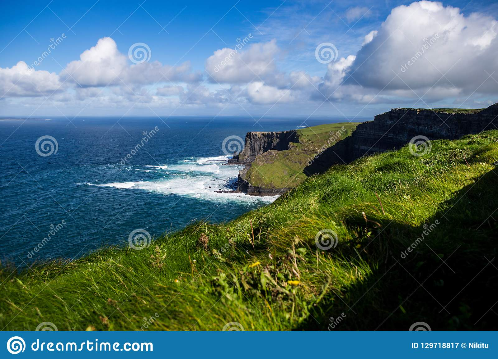 Cliffs of Moher at Alantic Ocean in Western Ireland with waves battering against the rocks