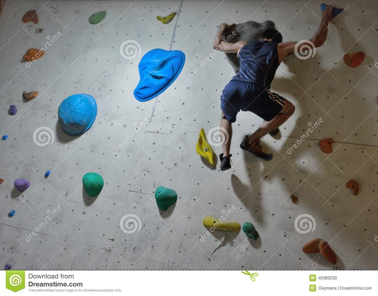 Climber Trying To Reach A Hold On Climbing Wall Editorial ...