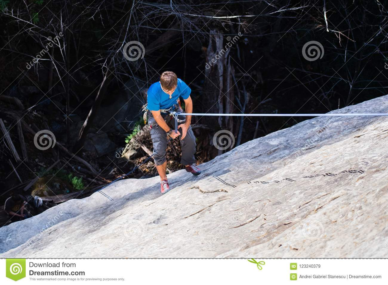 Climber Rappelling After Climbing A Rock Wall Editorial ...