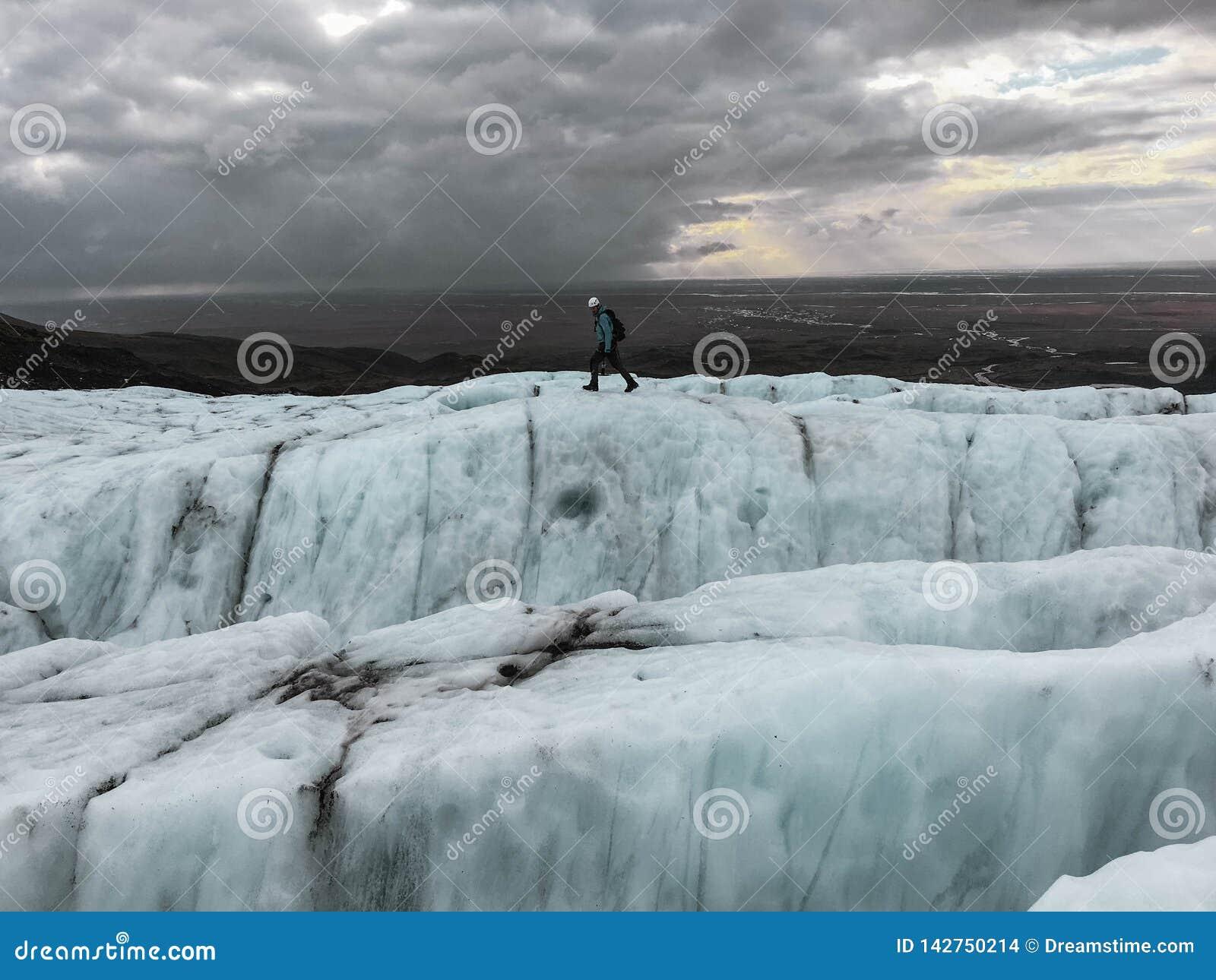 A climber walking across icelandic glaciers
