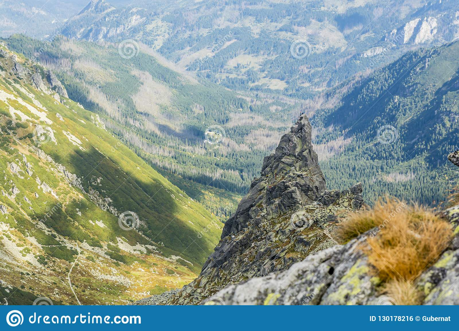 Climbers and mountain guides with clients while climbing the popular Mnich Monk peak in the Polish Tatras.