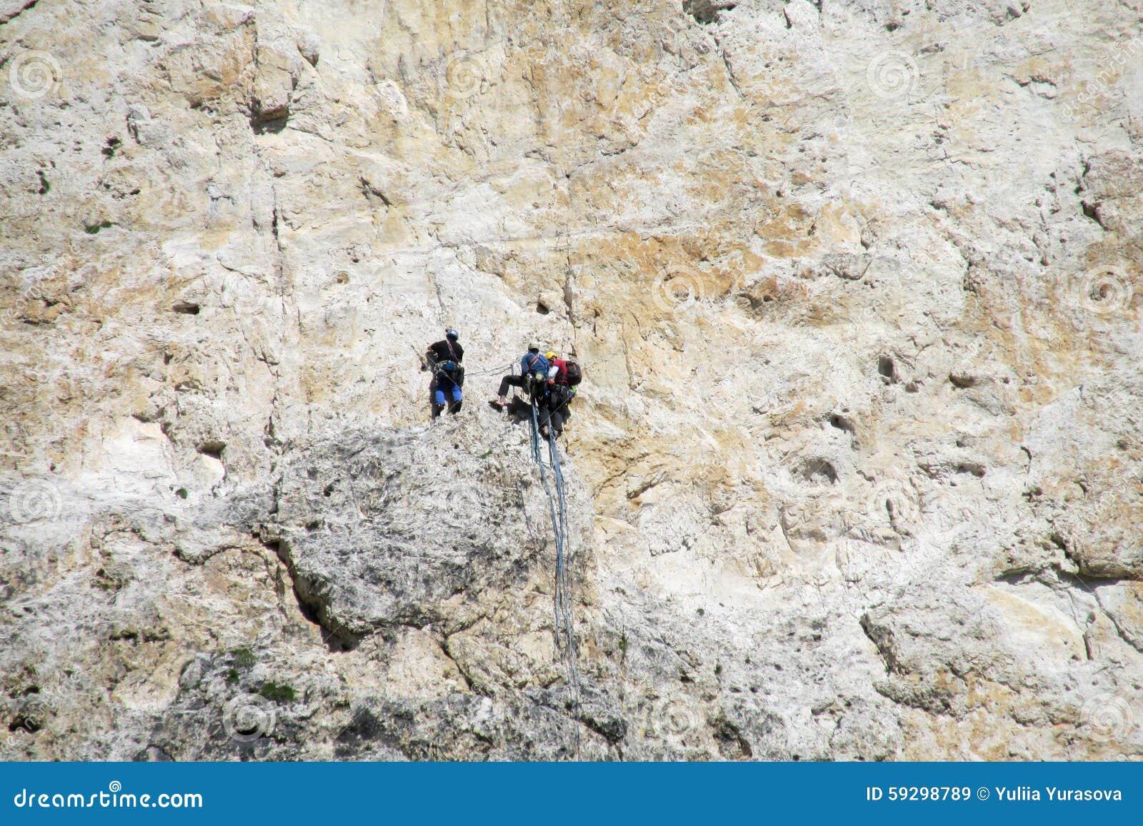 Climbers on mountain wall