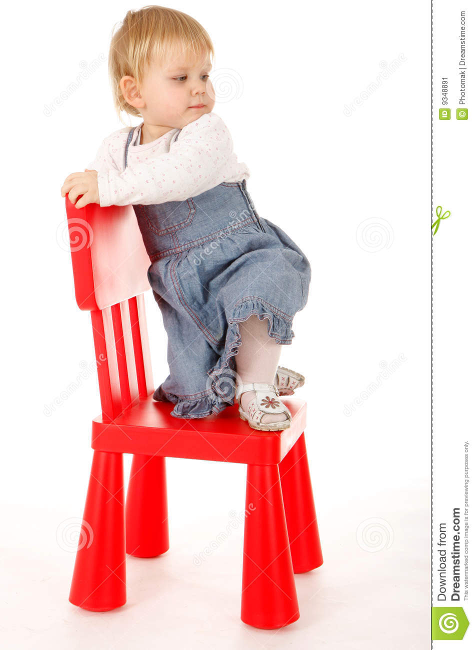 Climbing On Red Chair Little Girl Stock Image Image Of