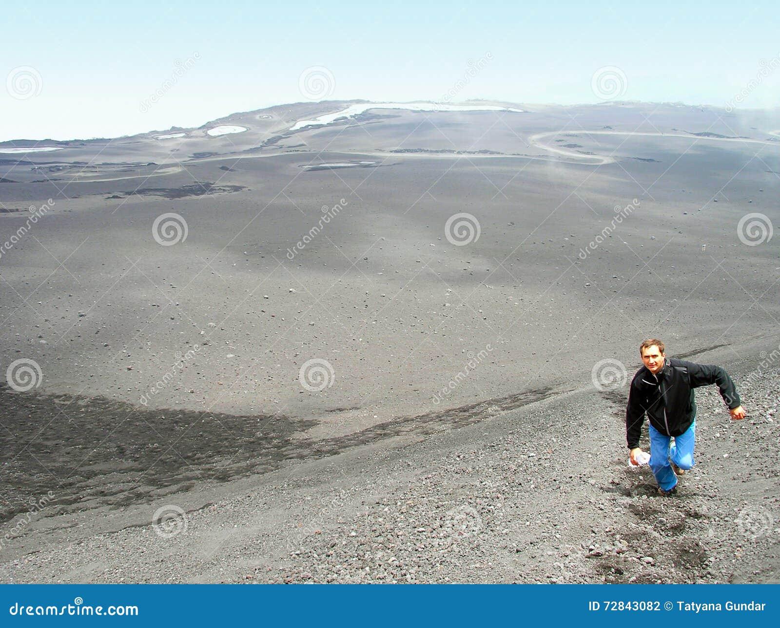 Climbing to top Mount Etna.