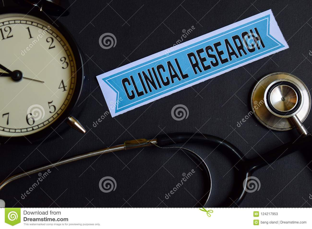 Clinical Research on the print paper with Healthcare Concept Inspiration. alarm clock, Black stethoscope.