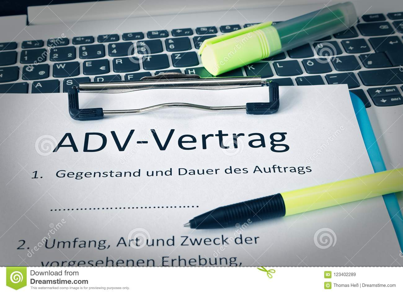 Clipboard With A Contract And Inscription In German ADV-Vertrag In ...