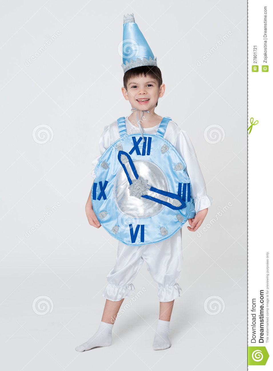 Boy wearing carnival costume of a clock for New Year party.