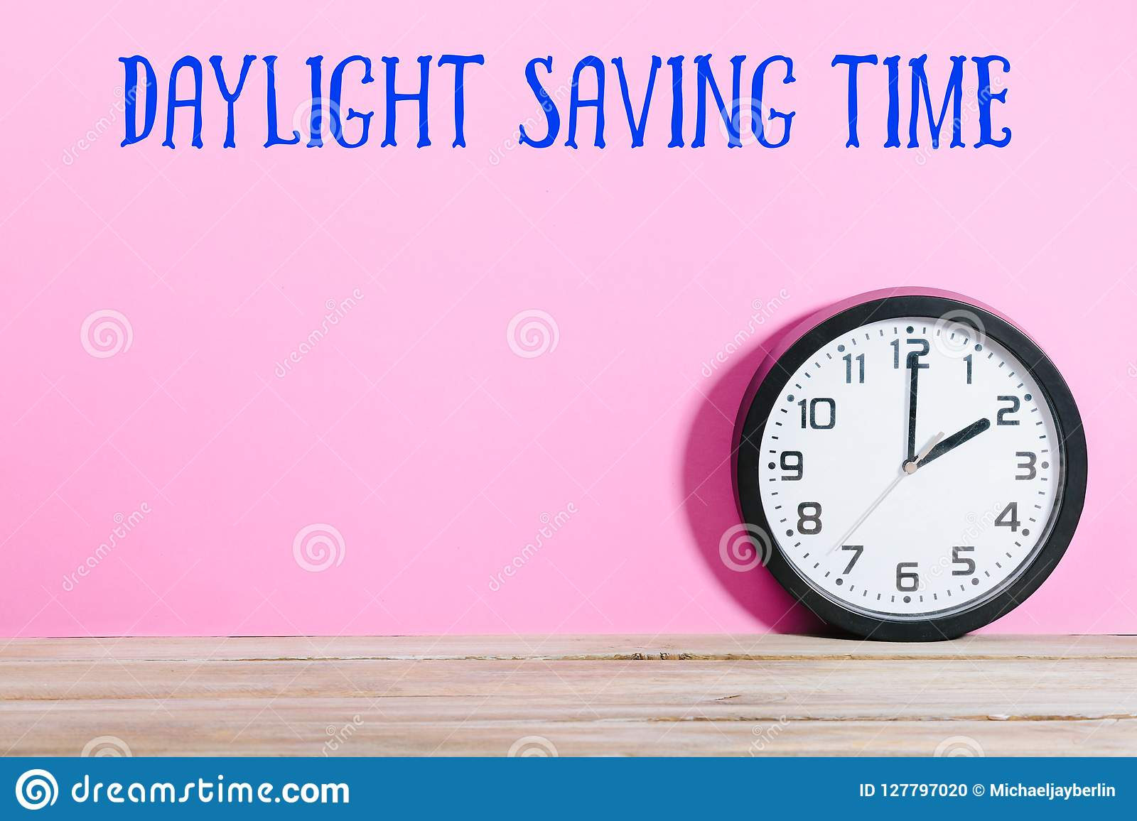 Clock On Table With Daylight Saving Time Message Stock Photo - Image
