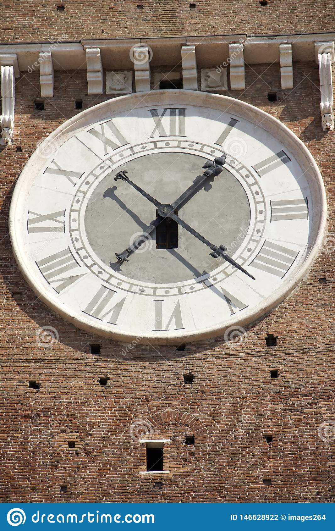 The clock on facade of the Bell Tower in Verona