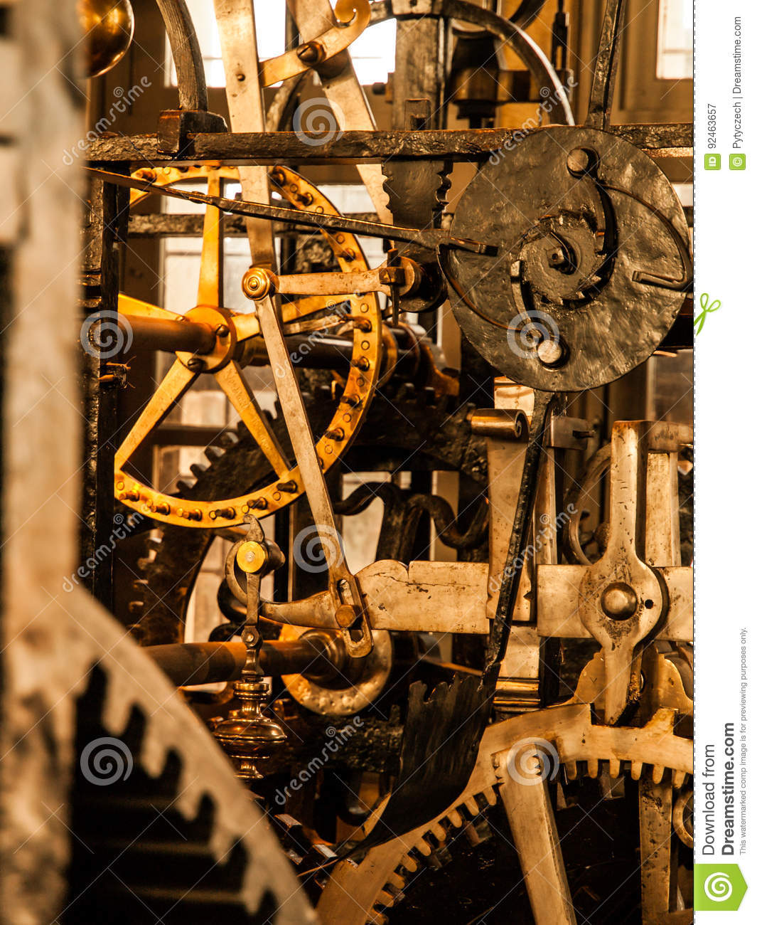 Clockwork mechanism. Close up view of cog wheels and other mechanical parts of vintage tower clock