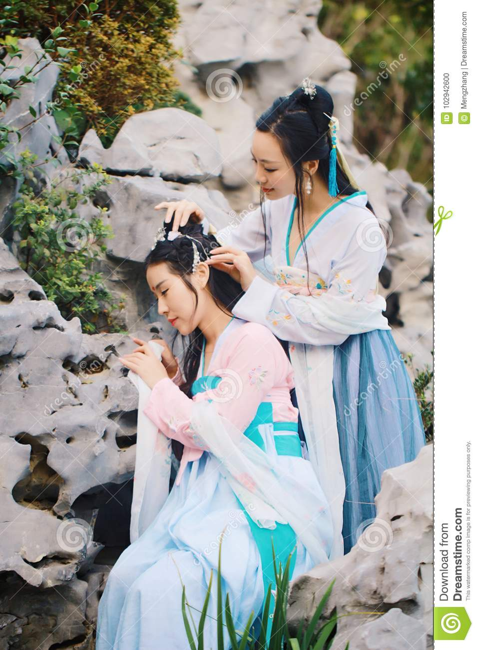371ba38f2 Close girlfriends bestie in Chinese traditional hanfu dress in a garden, ancient  chinese hanfu dress, graceful women forever friendship sweet girls hold ...
