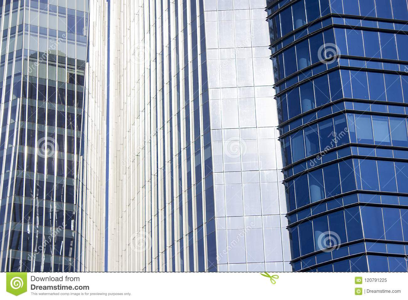 Close shot of a pair of twins corporate blue office buildings with a striped design.