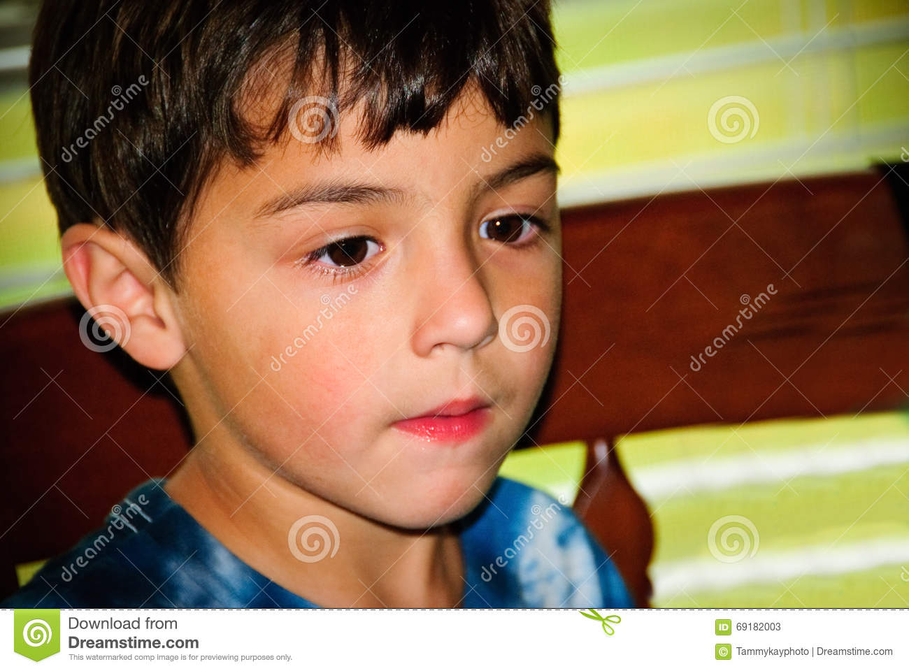 Close Up Of Adorable Little Boy Sitting In A Chair Stock Image