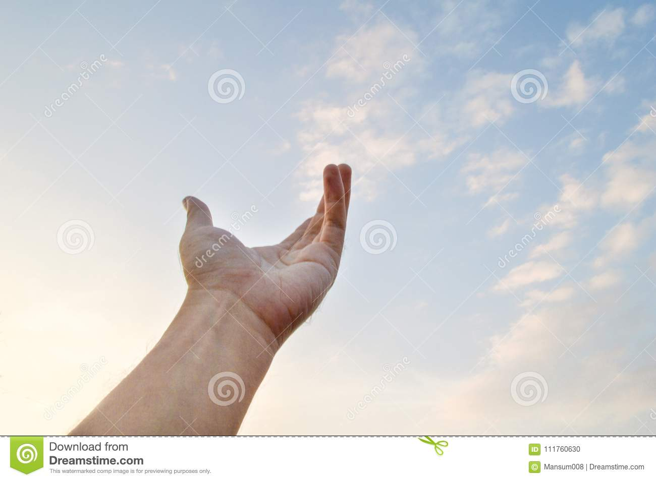 Adult hand reaching out towards the sky