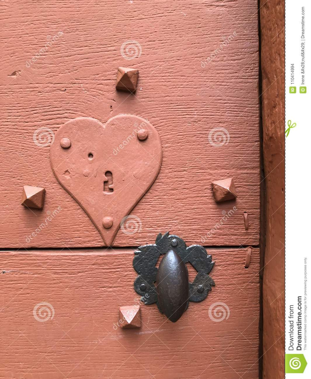 Ancient door with lock- keyhole with a heart