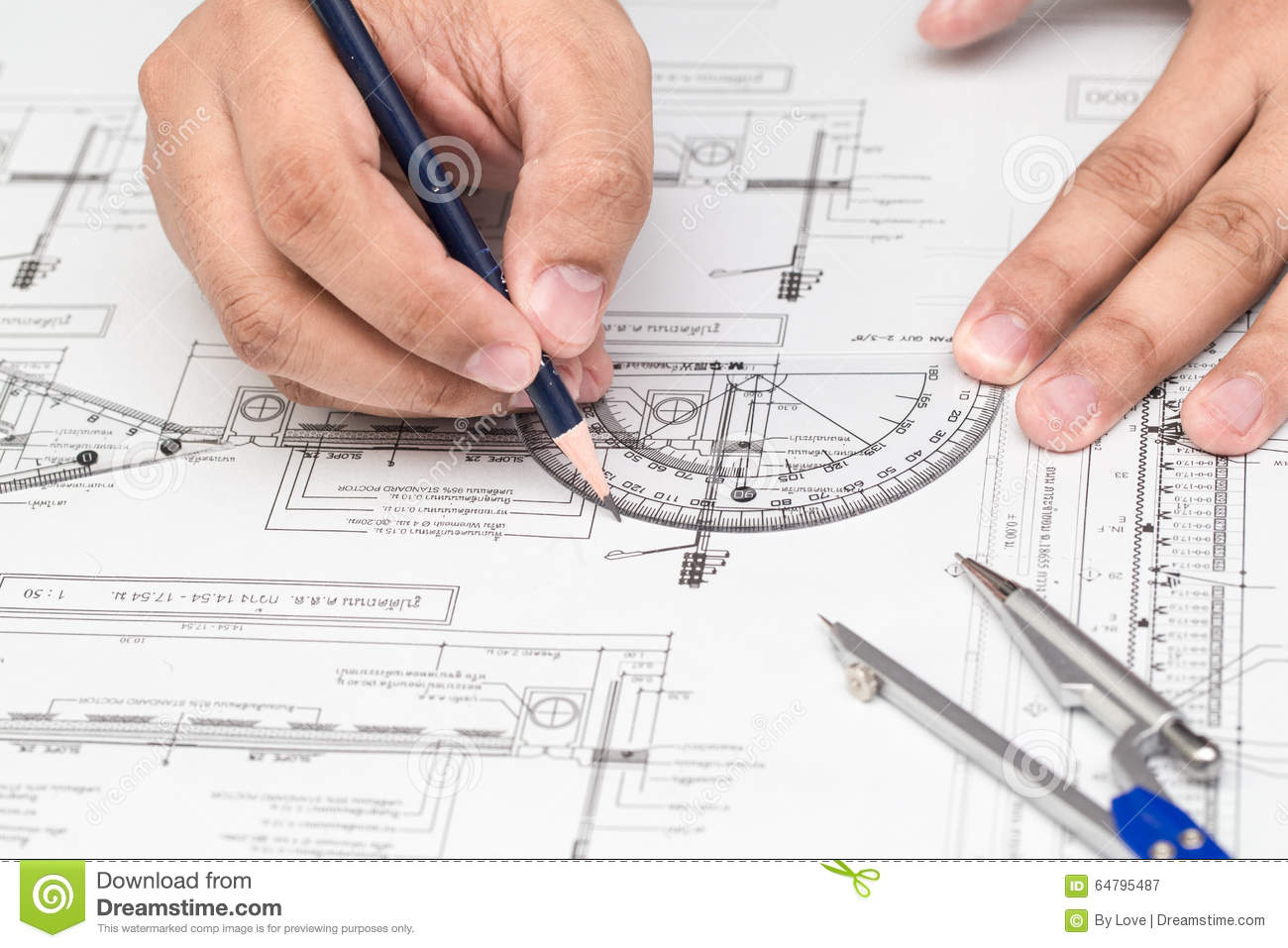 Close Up Of Architect Hands Working On A Blueprint In Office. Blueprints  Were Created By Photographer.