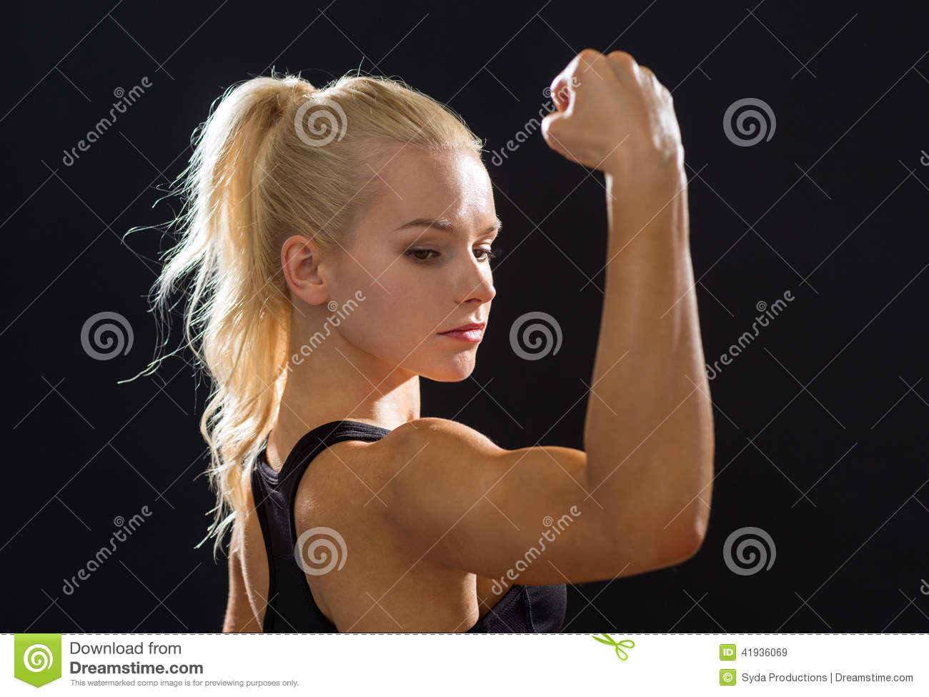 Close Up Of Athletic Woman Flexing Her Biceps Stock Photo