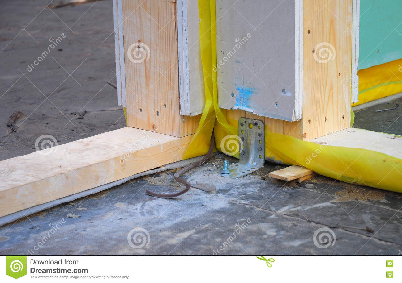Close Up On Attaching Wall Frame To Concrete Floor  Stock Photo