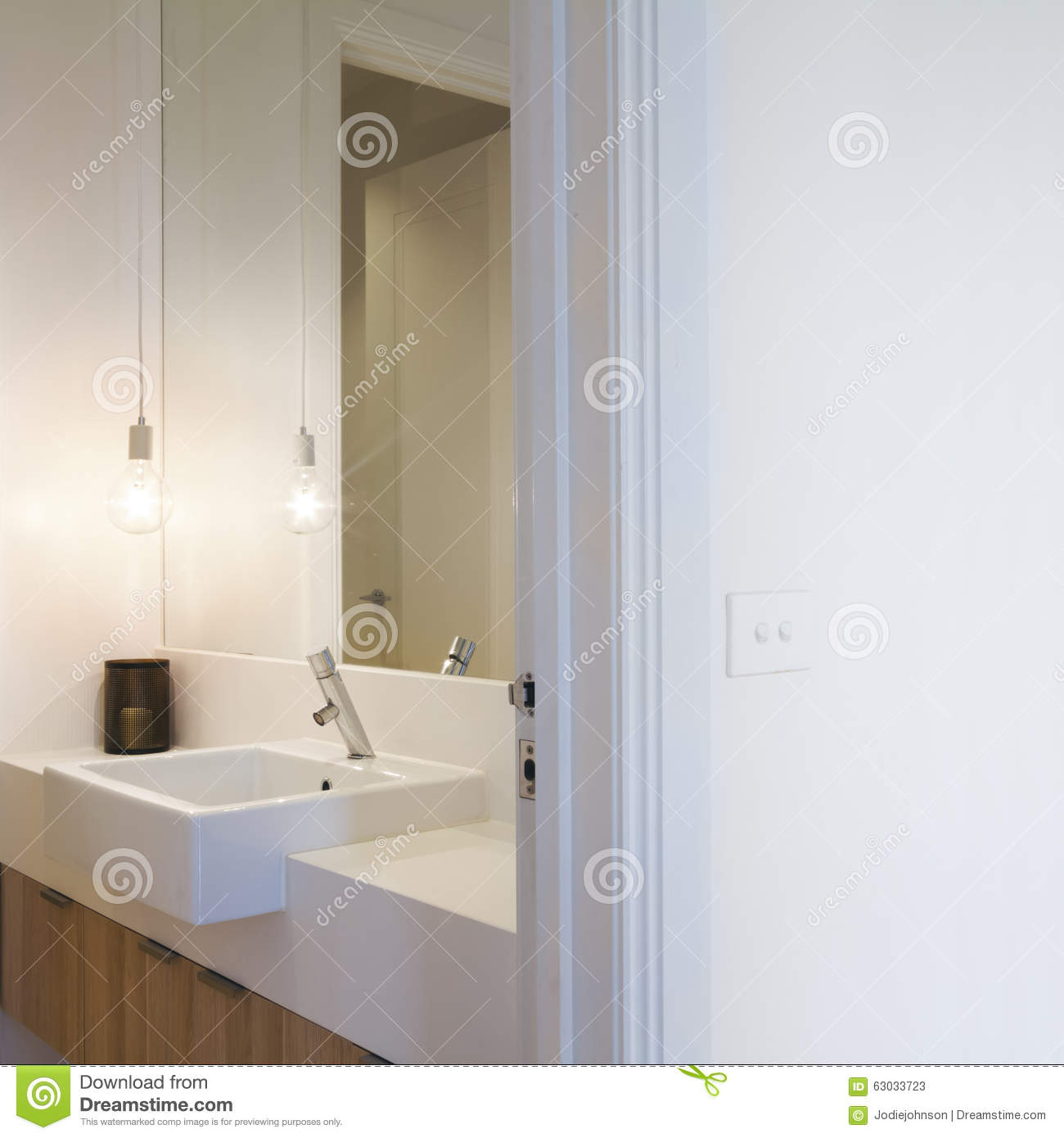 close up of australian light switch on wall and pendant light in rh dreamstime com