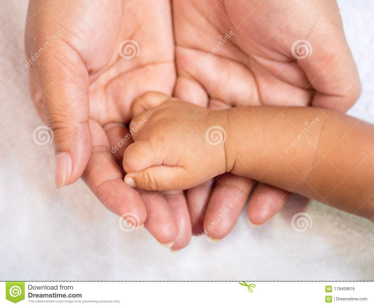 Close up baby hand on mother`s hands. Love and family concept.