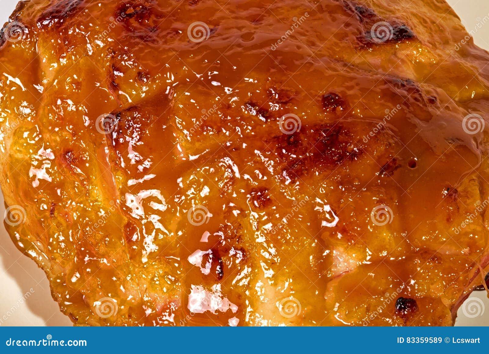 Close up of Baked Gammon Covered with Honey Based Glaze on White