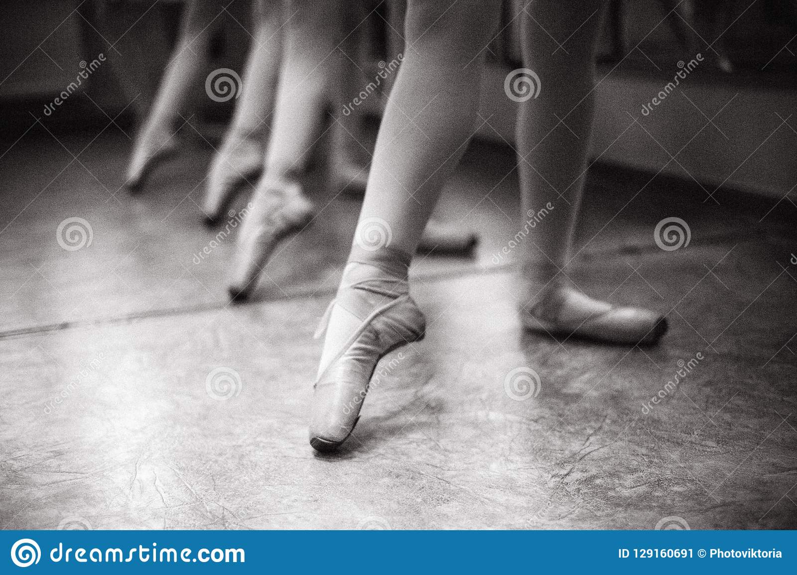 Close-up of ballerina feet on pointe shoes in the dance hall. V