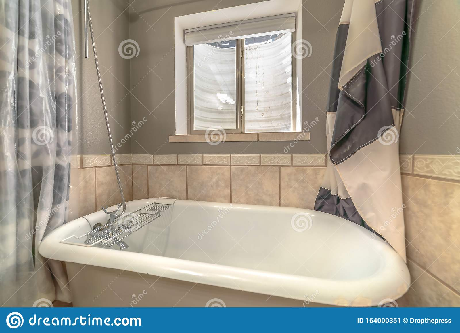 Close Up Of A Bathtub In Side A Bathroom With Shower Curtains And Window Stock Image Image Of Tile Details 164000351